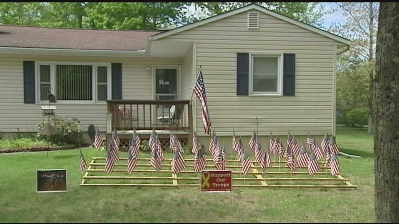 "Essex Junction man has 60 American flags posted in his lawn year round to recognize the 60 service members he and his wife have ""adopted"" over the years."