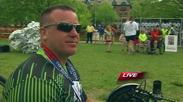 Larry Nadeau, of Springfield, was the first hand cyclist to finish the marathon in just over 90 minutes.