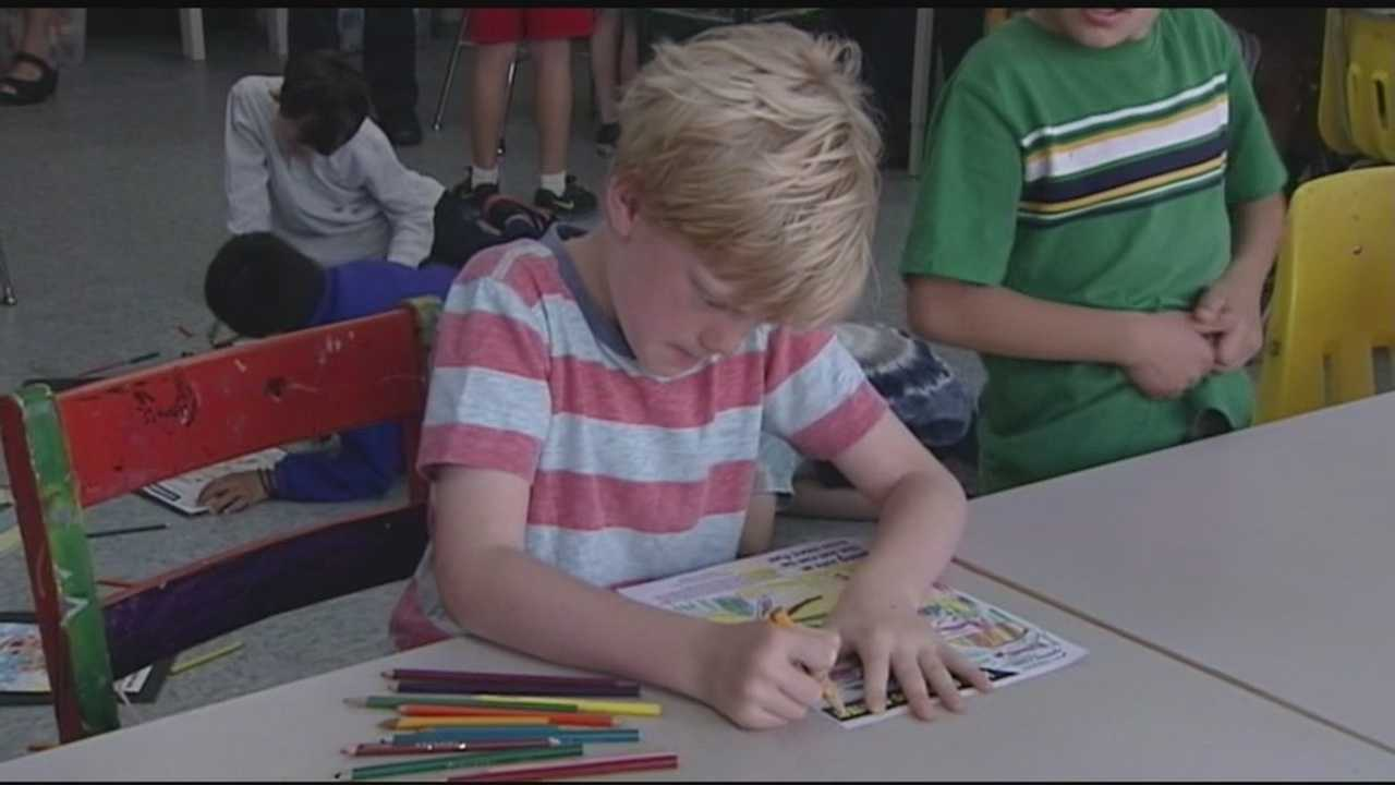 Student participating in new Vermont sun safety coloring initiative.