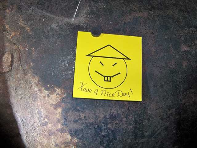 "A note containing what appears to be a crude caricature that said ""Have a Nice Day"" was left on the pipe that they cut through."