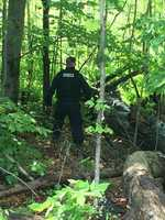 Photos from the village show police searching wooded areas.