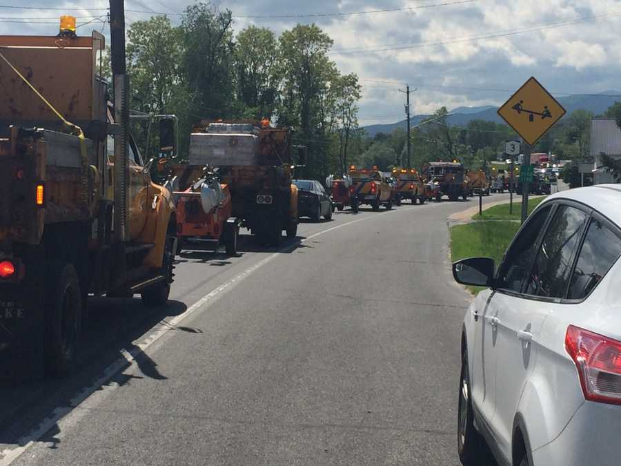 A convoy of trucks carrying giant light setups parked on Route 3 and Trudeau Road in Cadyville.