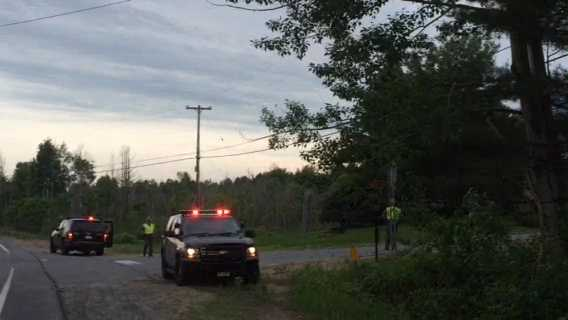 Police block the entrance to Cringle Road near the Cadyville/Saranac town line. Police were focusing their search for two inmates along the rural road.