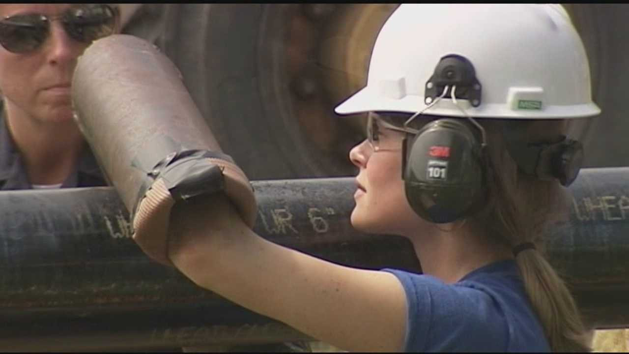 A Plainfield woman disrupted work on the Vermont Gas pipeline project Thursday when she locked herself to a mammoth steel pipe.