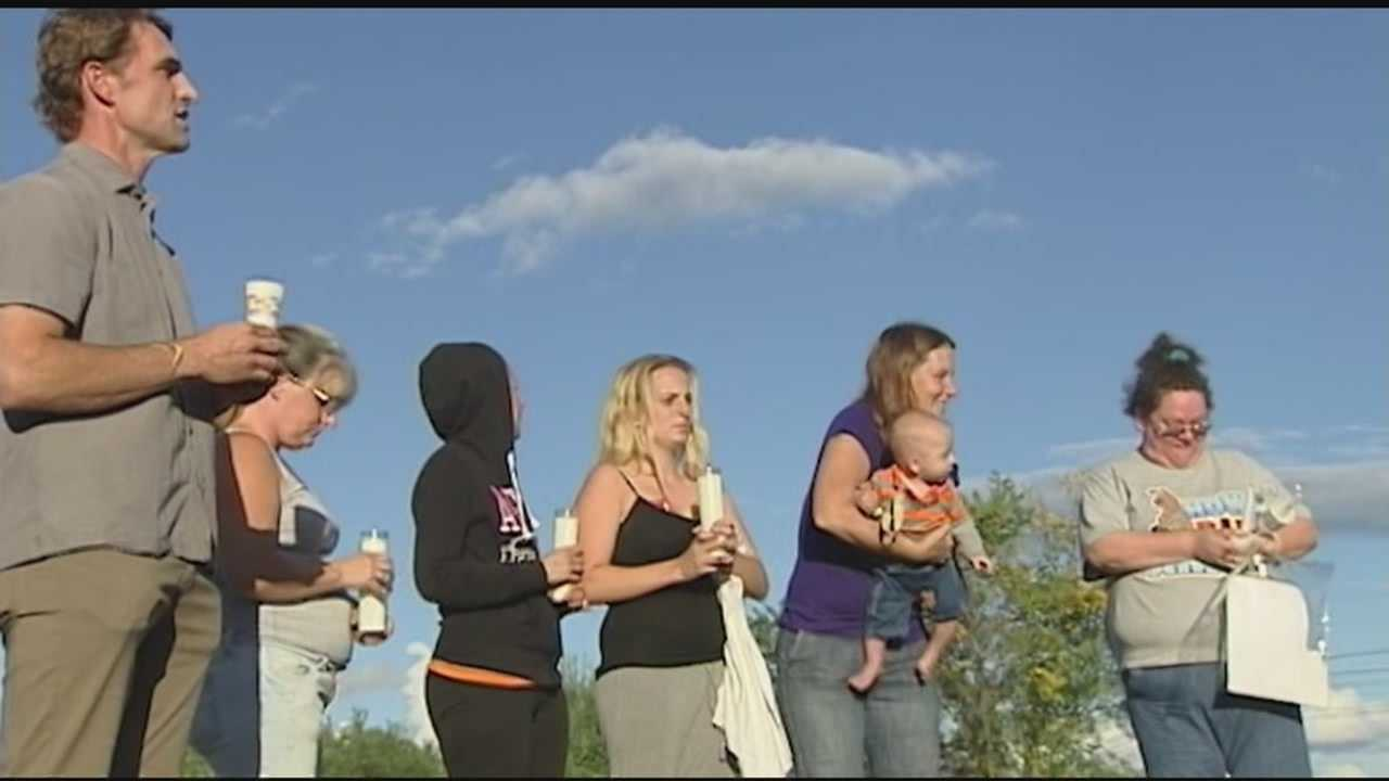 A community mourned Thursday night for a mother and her two daughters, who police say were murdered.