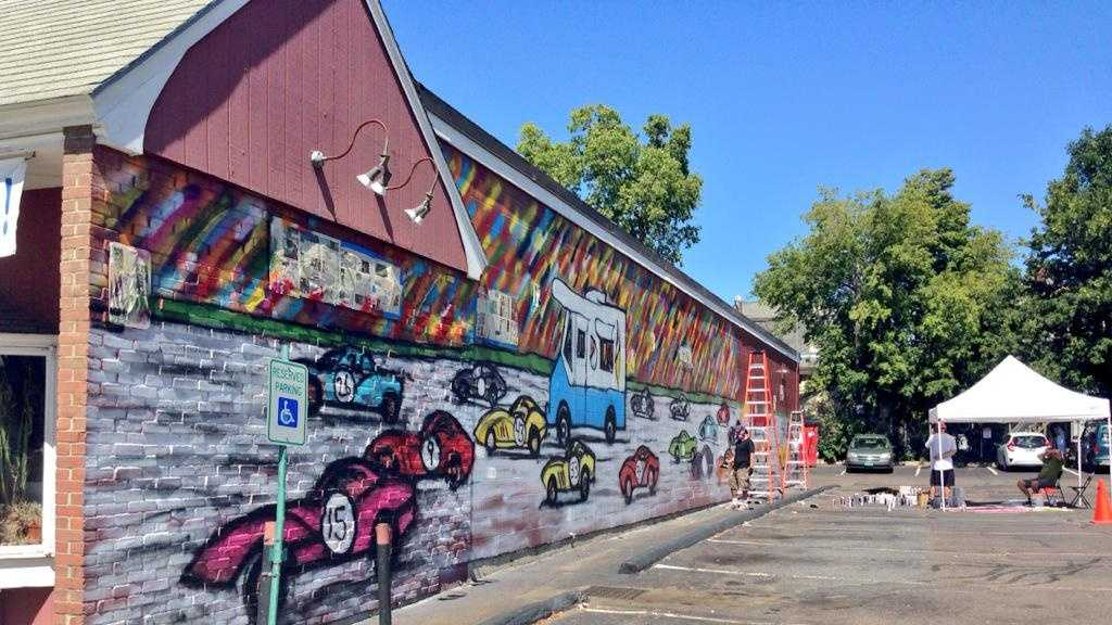 An eye-catching mural was completed Saturday in downtown Burlington at Pearl Street Beverage.