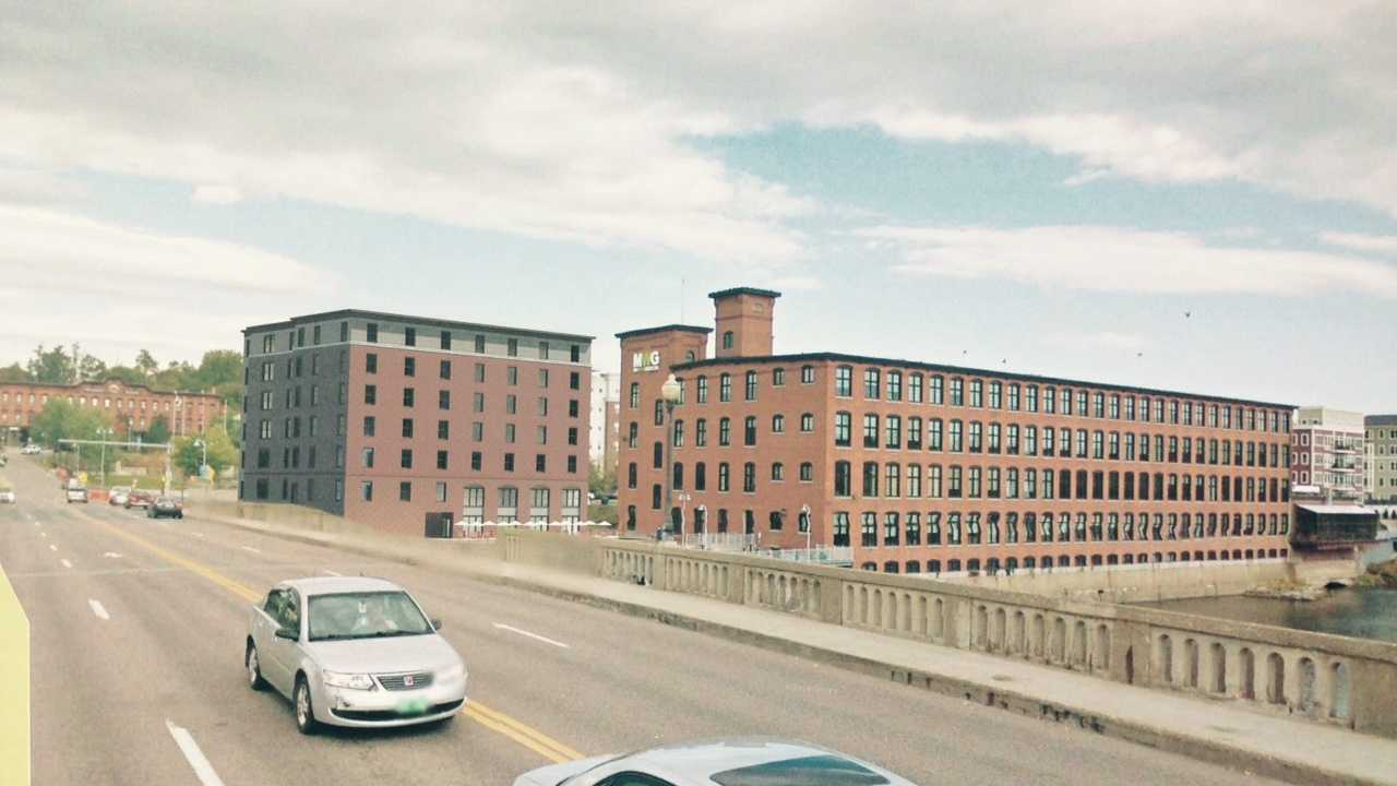Architect sketch of the proposed 93-room hotel between the Champlain Mill and Winooski bridge.