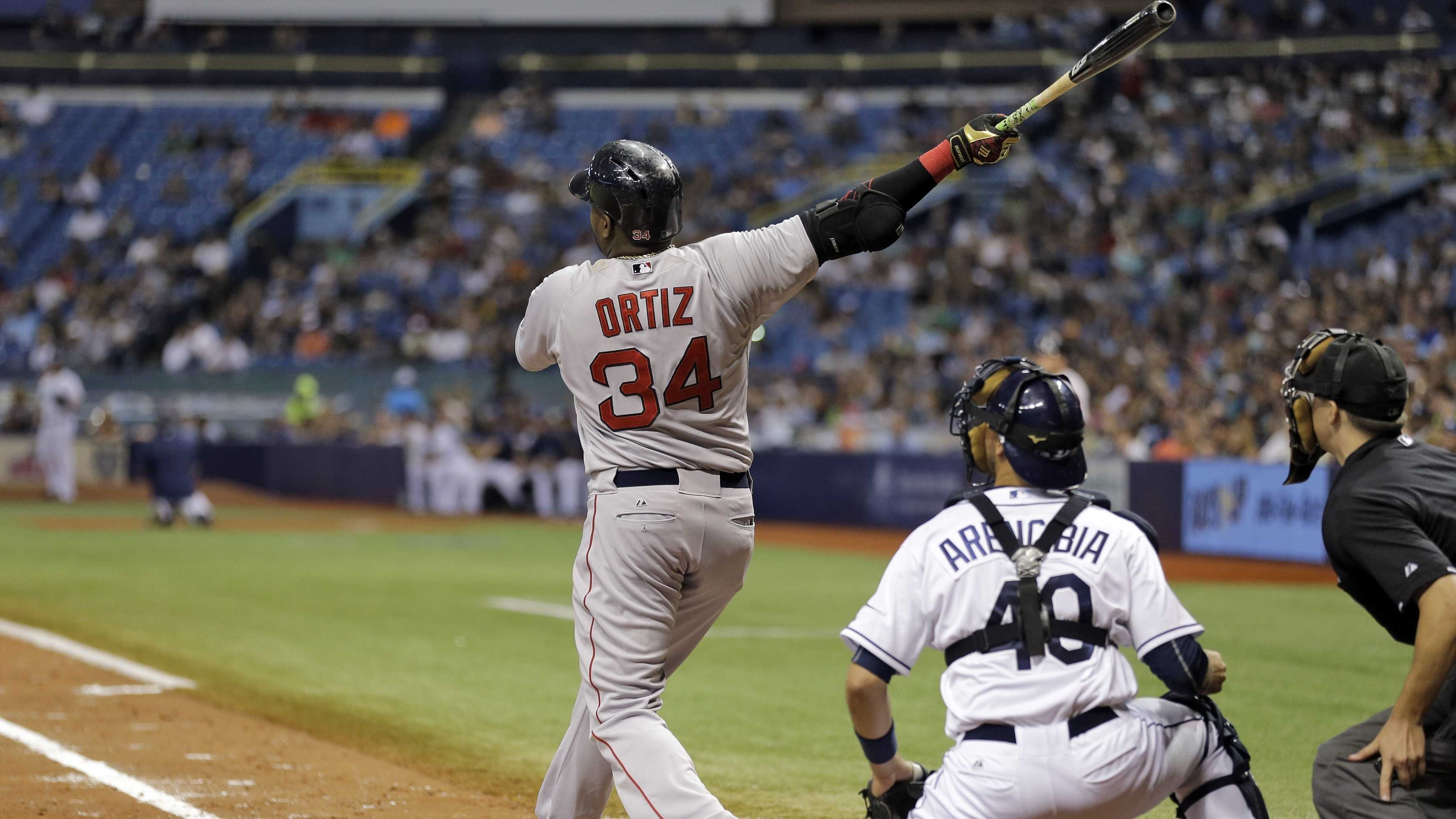 Boston Red Sox's David Ortiz watches his 500th career home run off Tampa Bay Rays starting pitcher Matt Moore during the fifth inning of a baseball game Saturday, Sept. 12, 2015, in St. Petersburg, Fla. watching is Rays catcher J.P. Arencibia, and home plate umpire Adam Hamari.