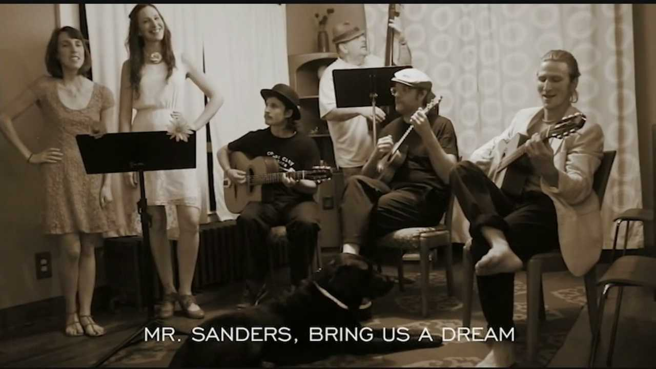 Crackin' Foxy, a musical group from Saranac Lake, shows their support for presidential hopeful Bernie Sanders through song.