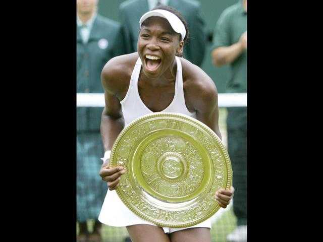 Venus Williams defeats Lindsay Davenport in two sets for her first championship at Wimbledon.