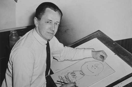 """Peanuts"" creator Cartoonist Charles Schulz dies in his sleep at the age of 77."