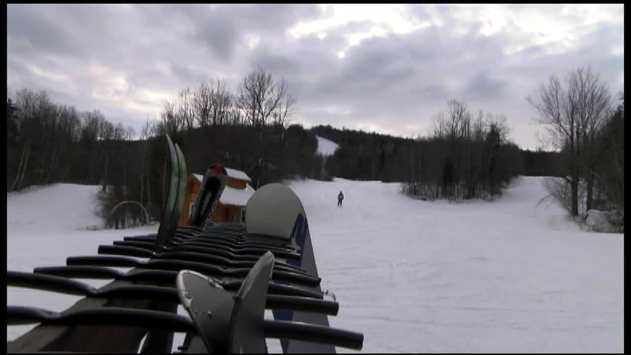 Police personnel ski and snowboard for free at Titus Mountain on Law Enforcement Appreciation Day.