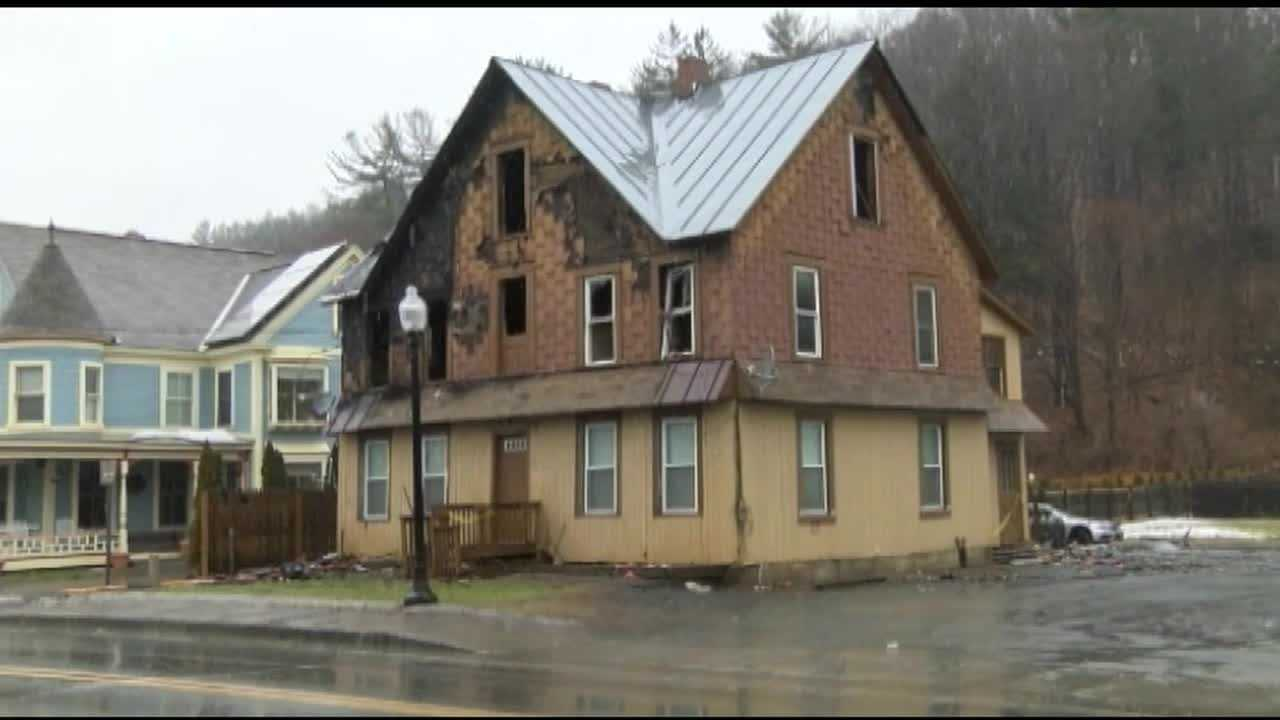 The Maple Street building was home to four families before a fire ripped through it Tuesday night, injuring one tenant and displacing all twelve that lived there.