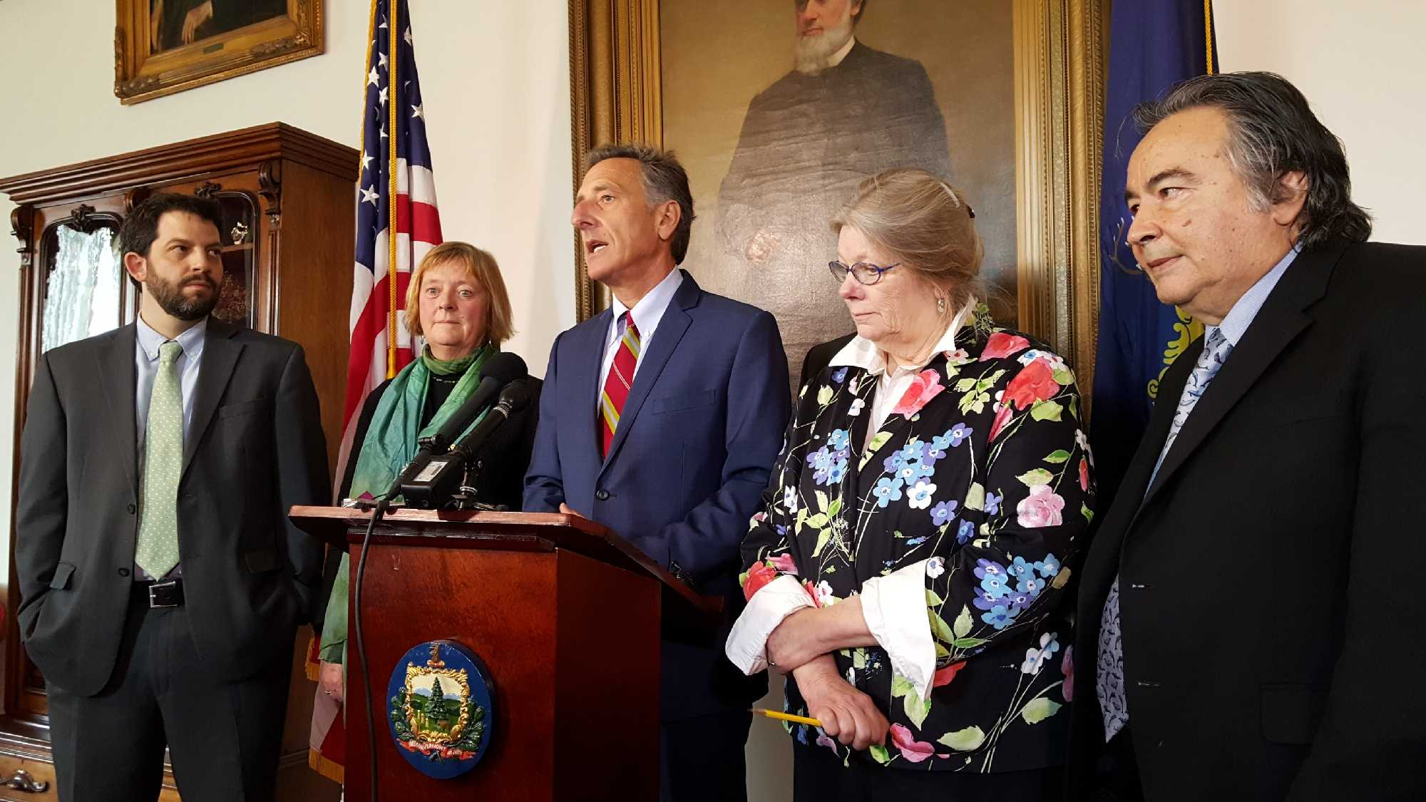 Gov. Shumlin speaks at the Statehouse Thursday, flanked by Reps. Chris Pearson and Mary Sullivan and Sens. Jeanette White and Anthony Pollina.