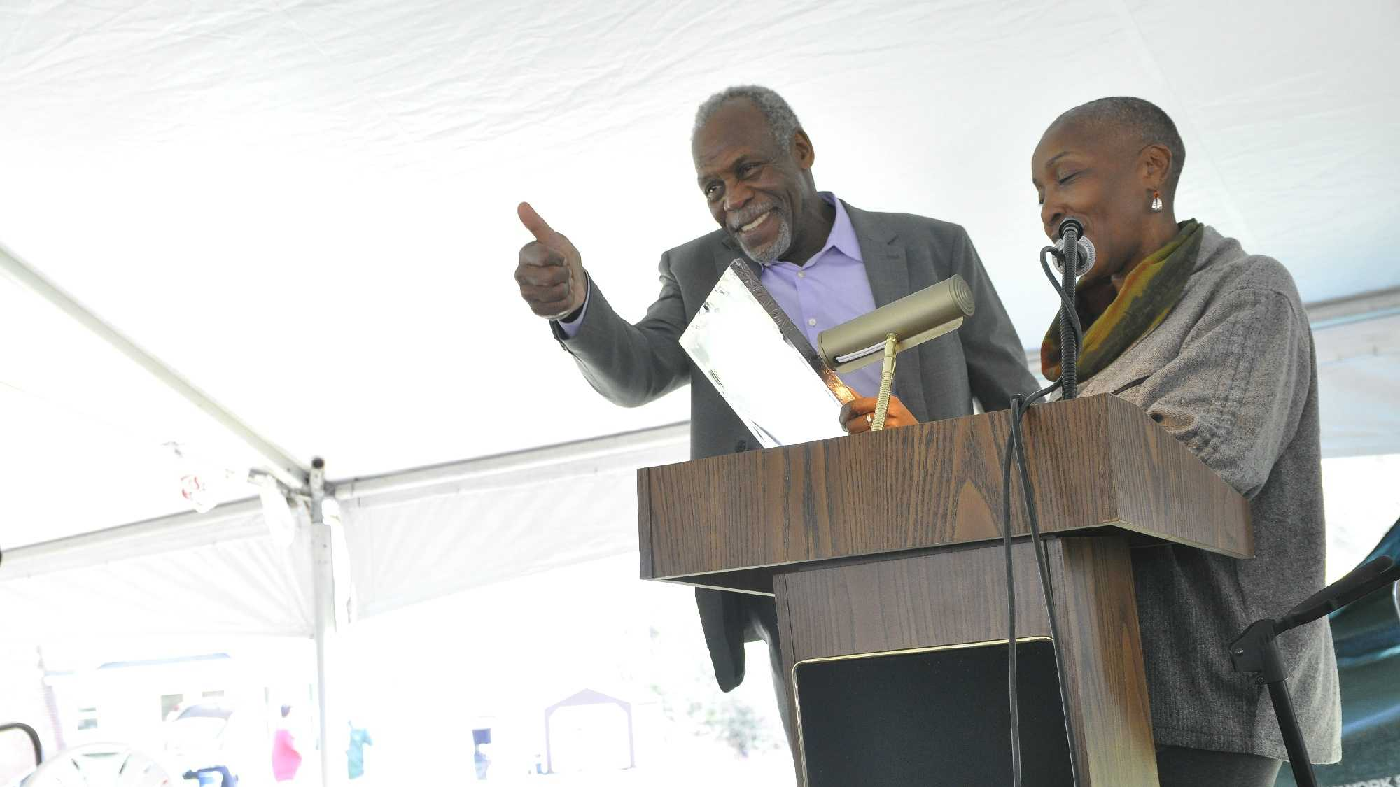 Danny Glover accepts the Spirit of John Brown Freedom Award from Soffiyah Elijah, executive director of the Correctional Association of New York.