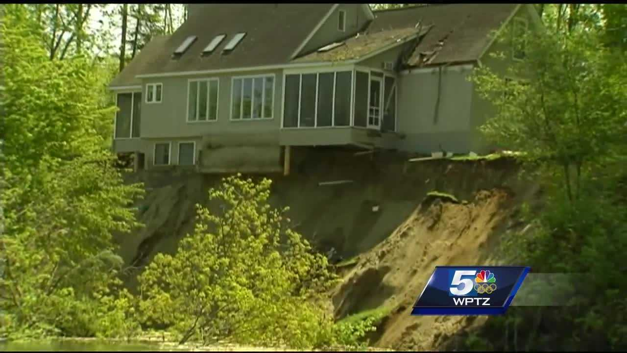 Sandy earth crumbing foundation at home on Winooski River