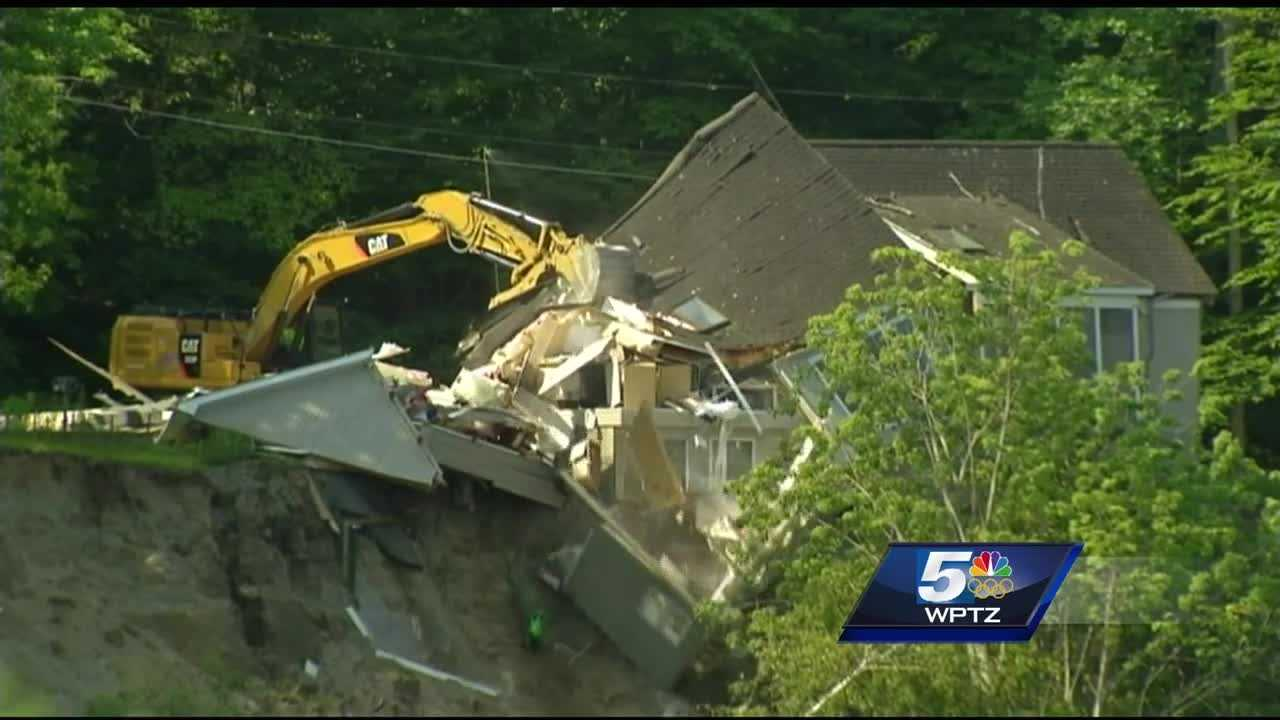 After teetering on the edge for nearly a month, a Burlington home is finally demolished.