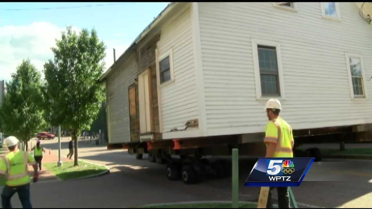Crews carted a historic Winooski home off its property Sunday in preparation for its move to Burlington