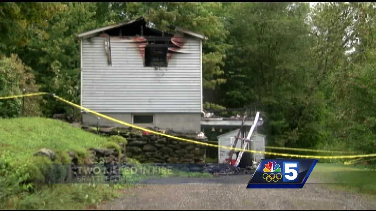 The fire department said dispatchers received a call about 11:45 p.m. reporting the fire at a mobile home on Record Drive.  A 911 caller reported visible flames and said two people were trapped inside the mobile home.
