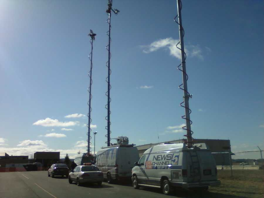Local media crews line the Vermont National Guard airport base where President Obama is expected to arrive.