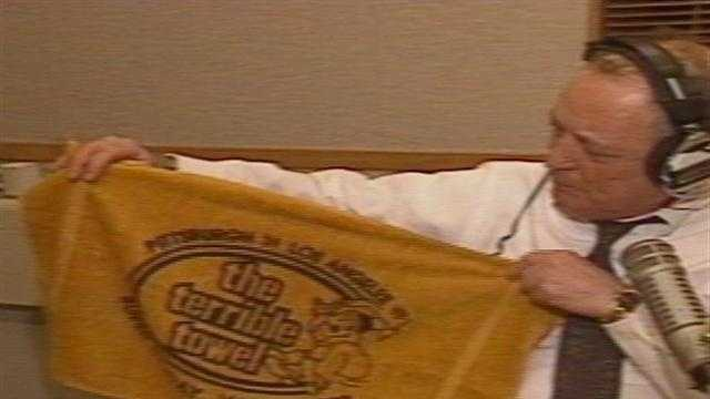 "Myron Cope holds up the ""Terrible Towel"""