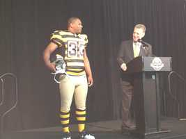 Running back Isaac Redman models the throwback uniform the Steelers will wear to celebrate their 80th season in 2012.