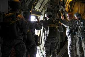 Members of the U.S. Army C-219 Special Forces Group (Airborne) prepare to jump out of a C-130 Hercules during the Wings Over Pittsburgh 2011 Air Show, Sept. 11.