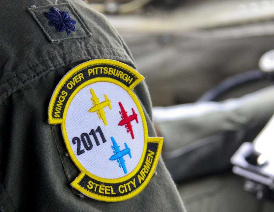 A pilot from the 758th Airlift Squadron wears the Wings Over Pittsburgh 2011 Air Show patch while flying a C-130 Hercules over the air show, Sept. 11. .