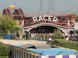 The Racer was built in 1927. It is a wooden roller coaster designed with a reverse curve so riders begin on the right and finish on the left.