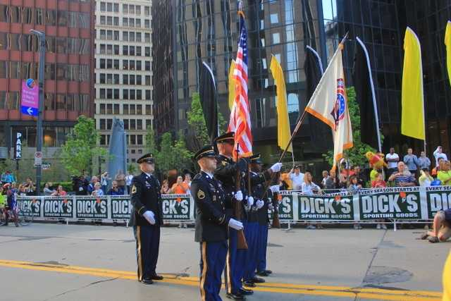 The displaying of the U.S. Flag for the singing of our National Anthem and the start of the 2012 Pittsburgh Marathon.