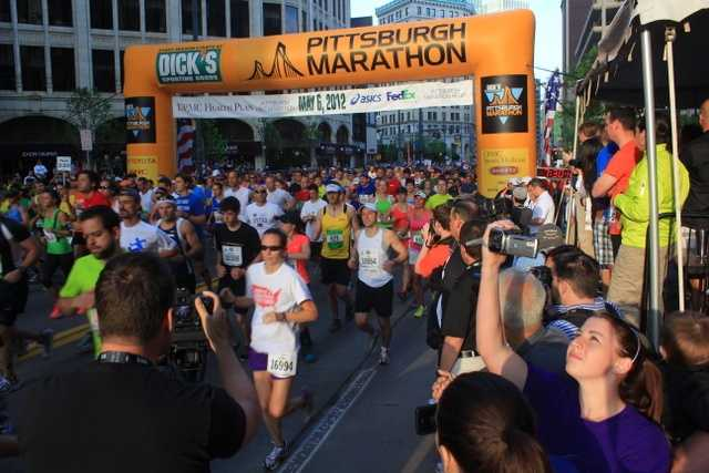 The gun is fired right at 7:30 a.m., and the runners are off!