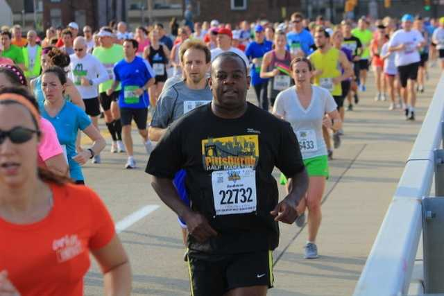 Channel 4 Action News Anchor/Sports Director Andrew Stockey was the first to pass our camera. He's breezing along at this point. He finished the half-marathon in 2:06:46.