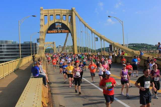 """Here's the second bridge the runners cross - the 9th Street bridge - featuring a Pittsburgh Marathon """"Runner of Steel"""" poster."""