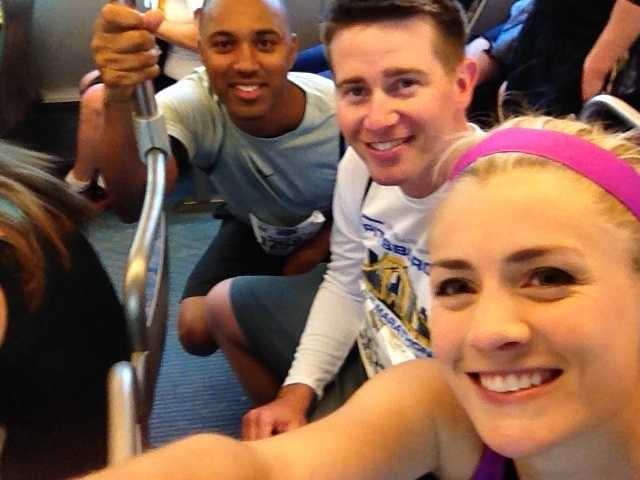 """Members of the Channel 4 Action News morning crew on the """"T"""" to the start line at Gateway Center."""