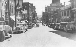 Main Street in Greensburg was filled with business in the early days of the 20th Century. This is a shot along main street looking south.