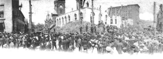 Large crowds are gathered in Downtown Greensburg for the construction of the fourth courthouse (1901-1907)