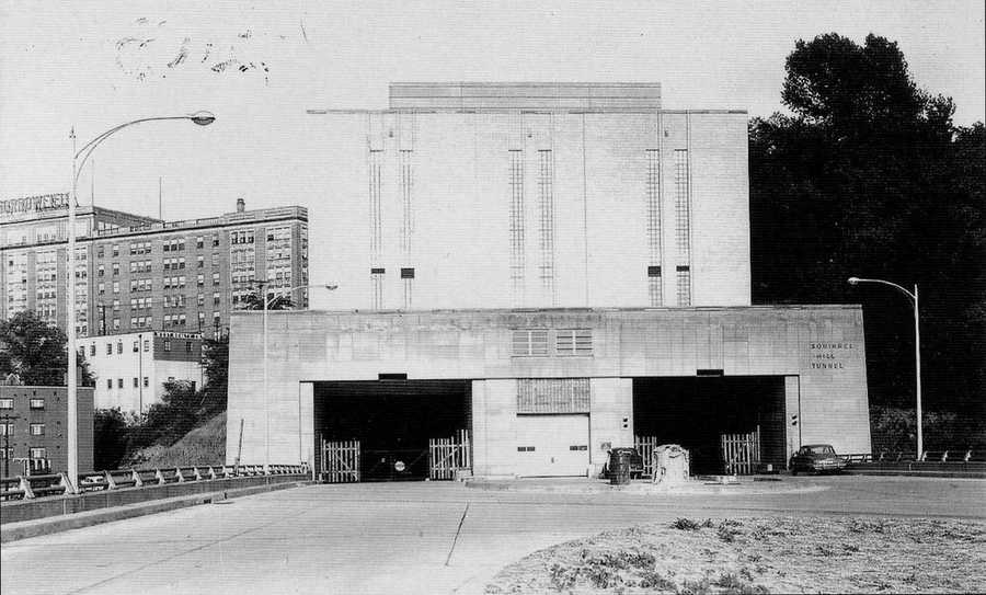 """May 1953: The Squirrel Hill Tunnel, with the Morrowfield apartment building in the background. A major celebration was held for the opening of the Penn-Lincoln Parkway, known today as the Parkway East (I-376).The older images in this slide show are from the book """"Squirrel Hill"""" prepared by the Squirrel Hill Historical Society and published by Arcadia Publishing. The full book may be purchased through Arcadia on their website."""