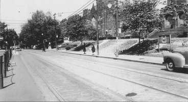 """The front steps of the Asbury Methodist Church along Forbes Avenue. Construction of the structure began in 1906. By 1966, attendance declined, and the church closed. The older images in this slide show are from the book """"Squirrel Hill"""" prepared by the Squirrel Hill Historical Society and published by Arcadia Publishing. The full book may be purchased through Arcadia on their website."""