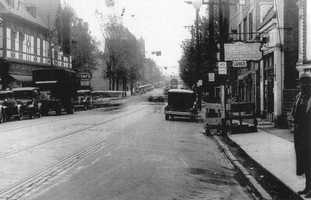 A photo from a similar perspective in 1932. The Manor Theater is located on the left.