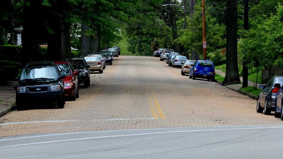 The two-way street retains brick pavement between Shady Avenue and Murray Avenue. This is the view looking west from Shady Avenue.