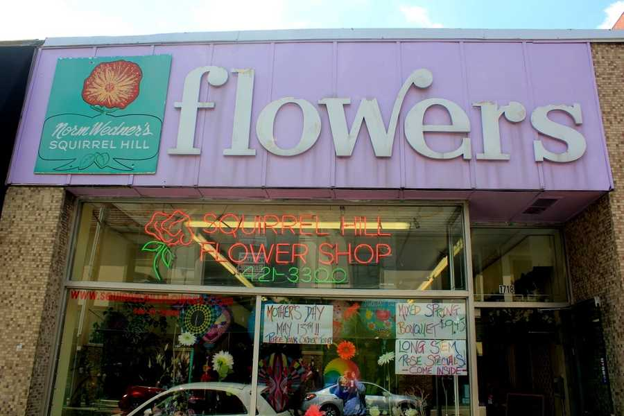 Today, a flower shop occupies one of the storefronts at that location on Murray Avenue.