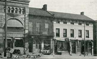 Site which is now the home of Citizen's Bank. Citizen's Bank bought the two houses in and completed construction in 1910. The old Citizen's Bank, started in 1885, can be seen to the left. - South Main Street