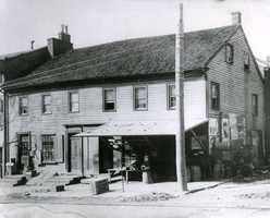 The Globe Inn was one of the earliest Inns in Washington. In May of 1825, its most famous visitor, Marquis de Lafayette, stayed while he was touring the National Road. - Corner of Strawberry Alley and Main Street.