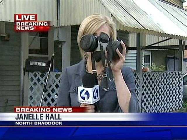 Reporter Janelle Hall holds one of the masks that Animal Control officers wore for protection inside the house.
