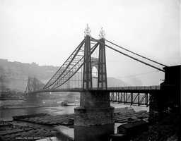 A close-up look at the old Point bridge in the year 1900.