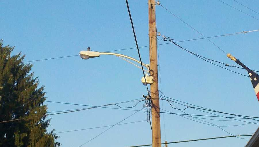 A security camera mounted on a utility pole.