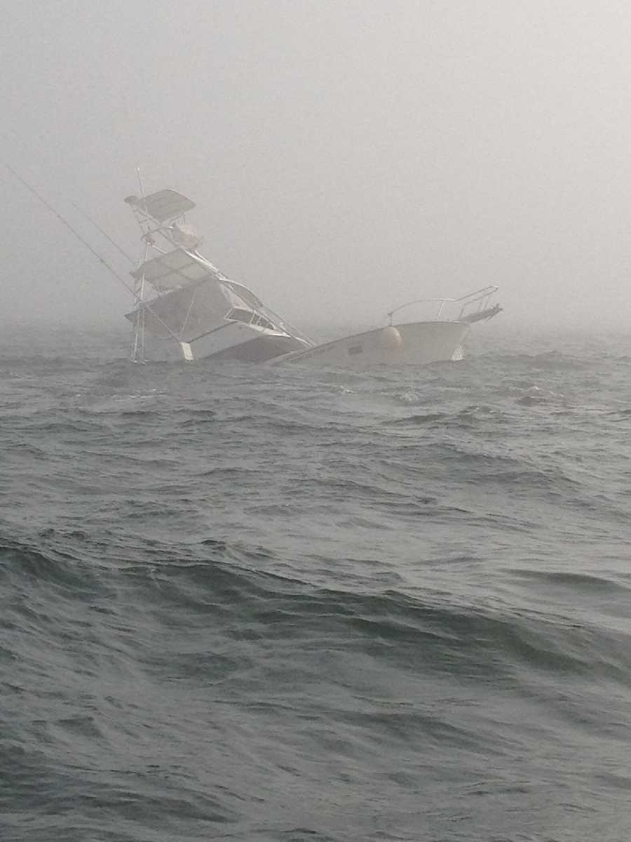 Courtesy: US Coast GuardThe Southern Comfort, a 38-foot fishing vessel, sinks after running aground on rocks while transiting the Barnegat Light's north jetty here, May 31, 2012.