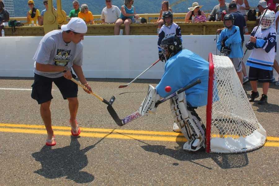 NHL Entry Draft top prospect Nail Yakupov, 18, of the Sarnia Sting plays some Dek Hockey on the Roberto Clemente Bridge.