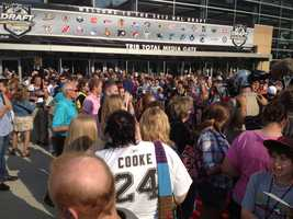 Fans gave the NHL prospects a warm welcome, standing outside the arena before the game, looking for autographs, and wishing the future professional hockey players well.