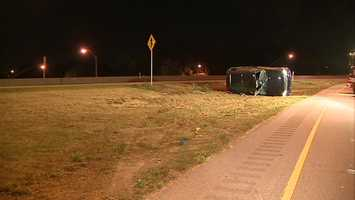A vehicle flipped over off of the Parkway East in Swissvale early Tuesday morning.